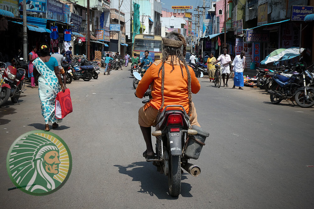 Spiritual itinerants, a Sadhus on a scooter